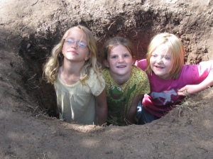 Cousin Paige, Hayley and Sydnie in the hole they had Dusty dig for them.